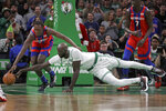 Boston Celtics center Tacko Fall (99) dives for the ball against Detroit Pistons forward Sekou Doumbouya, left, in the fourth quarter of an NBA basketball game, Friday, Dec. 20, 2019, in Boston. (AP Photo/Elise Amendola)