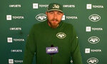 In a video grab from Zoom, New York Jets guard Alex Lewis speaks during a news conference Aug. 6, 2020, in Florham Park, N.J. The big guys up front on the Jets' offensive line got close while being far apart. Group texts. Silly memes. Funny jokes. Serious Zoom conversations. They all helped keep the lines of communication open during months of social-distanced bonding for a revamped unit loaded with several players who had never actually met each other in person until a few weeks ago because of the coronavirus pandemic. (New York Jets via AP)