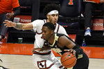 Purdue's guard Eric Hunter Jr. (2) powers past Illinois guard Andre Curbelo (5) in the first half of an NCAA college basketball game Saturday, Jan. 2, 2021, in Champaign, Ill. (AP Photo/Holly Hart)