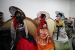 Models wait for their rehearsal before a face mask fashion show amid the coronavirus pandemic in Seoul, South Korea, Friday, July 24, 2020. (AP Photo/Lee Jin-man)