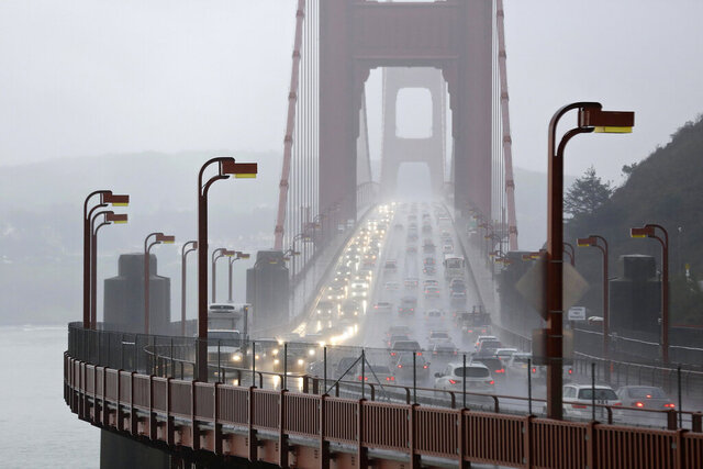 FILE - In this Jan. 5, 2016, file photo, traffic crosses the Golden Gate Bridge in the rain in this view from Sausalito, Calif. The Trump administration has ended its antitrust probe into a deal between California and four big automakers, after failing to find that the companies' conduct violated the law. (AP Photo/Eric Risberg, File)