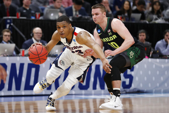 Gonzaga guard Zach Norvell Jr. (23) dribbles past Baylor guard Makai Mason (10) during the first half of a second-round game in the NCAA men's college basketball tournament Saturday, March 23, 2019, in Salt Lake City. (AP Photo/Jeff Swinger)
