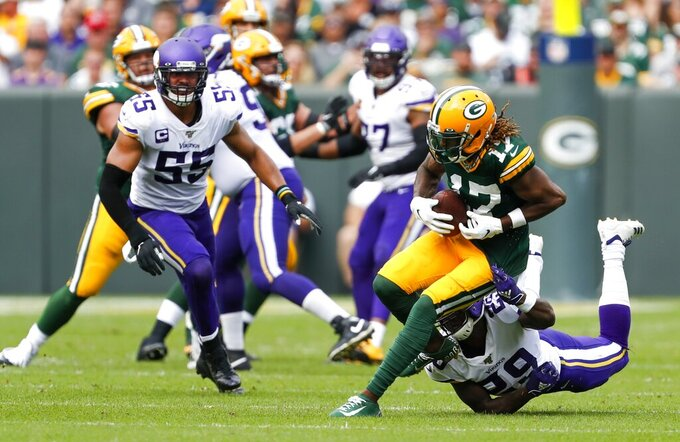 Green Bay Packers' Davante Adams runs after catching a pass during the second half of an NFL football game against the Minnesota Vikings Sunday, Sept. 15, 2019, in Green Bay, Wis. (AP Photo/Matt Ludtke)