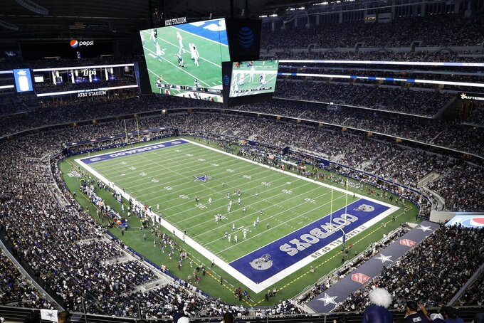 The Philadelphia Eagles are shown playing the Dallas Cowboys in the second half of an NFL football game at AT&T stadium in Arlington, Texas, Monday, Sept. 27, 2021. (AP Photo/Roger Steinman)