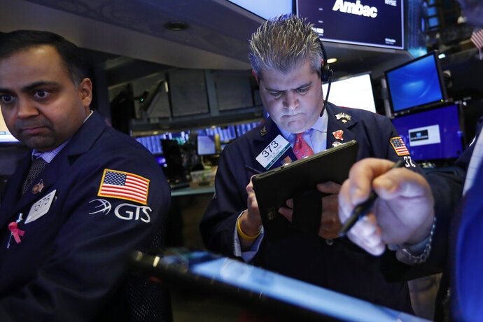 FILE - In this Feb. 5, 2020, file photo specialist Dilip Patel, left, and trader John Panin work on the floor of the New York Stock Exchange. The U.S. stock market opens at 9:30 a.m. EST on Thursday, Feb. 20. (AP Photo/Richard Drew, File)