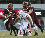 Virginia Tech quarterback Ryan Willis (5) runs into the Miami backfield during the first half of an NCAA college football game in Blacksburg, Va., Saturday, Nov. 17 2018. (Matt Gentry/The Roanoke Times via AP)
