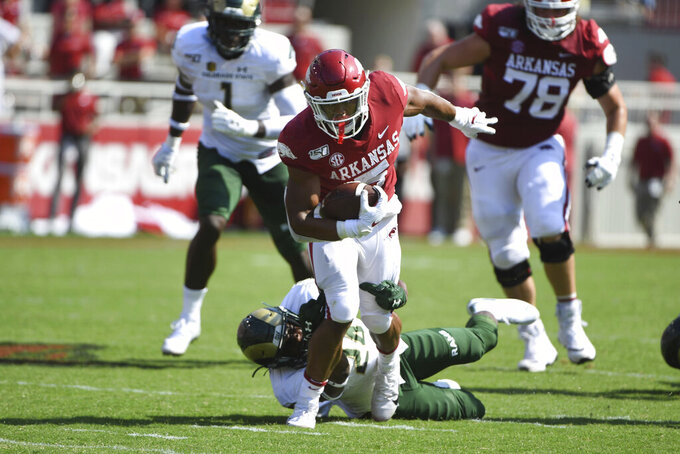 Arkansas running back Rakeem Boyd tries to get past Colorado State defender Tron Folsom during the first half of an NCAA college football game Saturday, Sept. 14, 2019 in Fayetteville, Ark. (AP Photo/Michael Woods)
