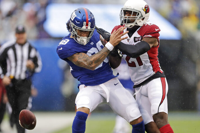 New York Giants' Evan Engram, left, is defended by Arizona Cardinals' Patrick Peterson during the first half of an NFL football game, Sunday, Oct. 20, 2019, in East Rutherford, N.J. (AP Photo/Adam Hunger)