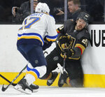 Vegas Golden Knights center Chandler Stephenson (20) passes around St. Louis Blues left wing Jaden Schwartz (17) during the third period of an NHL hockey game Saturday, Jan. 4, 2020, in Las Vegas. (AP Photo/John Locher)