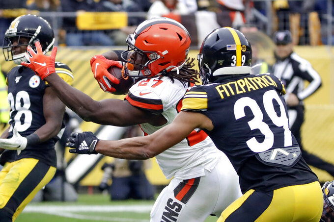 Cleveland Browns running back Kareem Hunt (27) scores a touchdown past Pittsburgh Steelers free safety Minkah Fitzpatrick (39) in the first half of an NFL football, Sunday, Dec. 1, 2019, in Pittsburgh. (AP Photo/Gene J. Puskar)