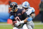Detroit Lions defensive end Trey Flowers (90) wraps up Chicago Bears quarterback Mitchell Trubisky (10) during the first half of an NFL football game in Chicago, Sunday, Nov. 10, 2019. (AP Photo/Charlie Neibergall)