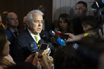 Roberto Castello Branco, president of Brazilian state-run oil company Petrobras, speaks to journalists after an oil auction in Rio de Janeiro, Brazil, Wednesday, Nov. 6, 2019. Brazil held one of the world's biggest-ever oil auctions, with oil majors bidding on fields currently operated by state-run Petrobras. (AP Photo/Leo Correa)