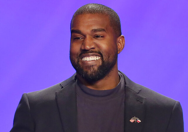 "FILE - This Nov. 17, 2019, file photo shows Kanye West on stage during a service at Lakewood Church in Houston. A law firm with ties to prominent Democrats has filed a lawsuit attempting to keep West off presidential ballots in Virginia. Attorneys for Perkins Coie filed a lawsuit in Richmond on Tuesday, Sept. 1, 2020, on behalf of two people who say they were tricked into signing an ""Elector Oath"" backing West's candidacy. (AP Photo/Michael Wyke, File)"