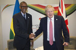 Britain's Prime Minister Boris Johnson, right, shakes hands with President of Rwanda Paul Kagame at the UK Africa Investment Summit in London, Monday Jan. 20, 2020. Boris Johnson is hosting 54 African heads of state or government in London. The move comes as the U.K. prepares for post-Brexit dealings with the world. (Eddie Mulholland/Pool via AP)