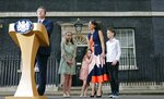 FILE - In this Wednesday, July 13, 2016 file photo Britain's Prime Minister David Cameron, speaks to the media as his wife Samantha and their children Nancy, Florence and Elwen, from left, look on as they leave 10 Downing Street, in London after he resigned. Britain's love-hate relationship with the rest of Europe goes back decades, but the Brexit crisis gripping it today stems from dramatic January 2013 speech by Prime Minister David Cameron in which he promised an