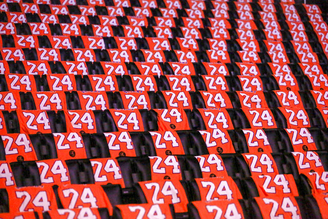 The Los Angeles Lakers honor the late Kobe Bryant by laying out t-shirts for fans prior to an NBA game against the Portland Trail Blazers at Staples Center Friday, Jan. 31, 2020, in Los Angeles. Bryant, the 18-time NBA All-Star who won five championships and became one of the greatest basketball players of his generation during a 20-year career with the Los Angeles Lakers, died in a helicopter crash Sunday. (AP Photo/Ringo H.W. Chiu)