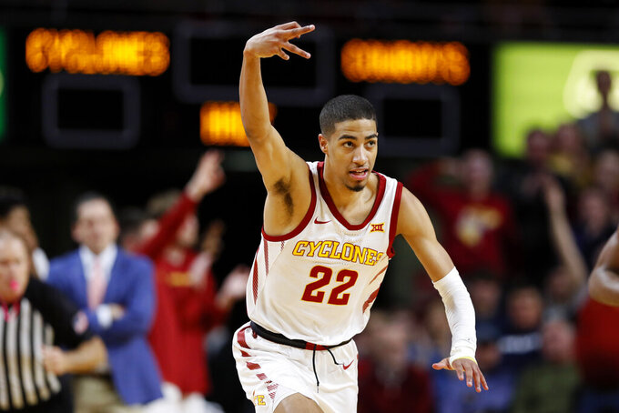 Iowa State guard Tyrese Haliburton celebrates after making a three-point basket during the second half of an NCAA college basketball game against Oklahoma State, Tuesday, Jan. 21, 2020, in Ames, Iowa. Iowa State won 89-82. (AP Photo/Charlie Neibergall)