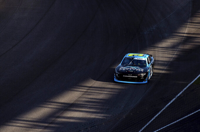 Sage Karam (31) drives out of the final turn during practice for the NASCAR Xfinity Series auto race at Indianapolis Motor Speedway, Friday, Aug. 13, 2021, in Indianapolis. (AP Photo/Doug McSchooler)