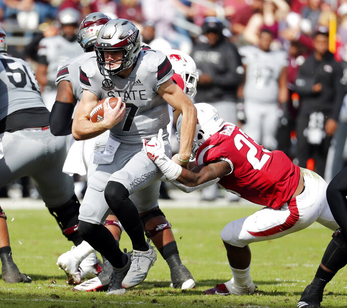 Mississippi State quarterback Nick Fitzgerald (7) runs with the ball against Arkansas during the first half of an NCAA college football game in Starkville, Miss., Saturday, Nov. 17, 2018. Mississippi State won 52-6. (AP Photo/Rogelio V. Solis)