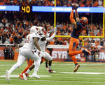 Syracuse linebacker Kielan Whitner, right, intercepts a pass by Louisville quarterback Sean McCormack during the first half of an NCAA college football game in Syracuse, N.Y., Friday, Nov. 9, 2018. (AP Photo/Adrian Kraus)