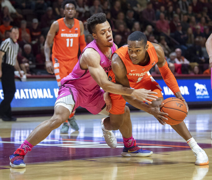 Virginia Tech guard Wabissa Bede (3) defends against Syracuse guard Jalen Carey (5) during the first half of an NCAA college basketball game Saturday, Jan. 26, 2019, in Blacksburg, Va. (AP Photo/Don Petersen)