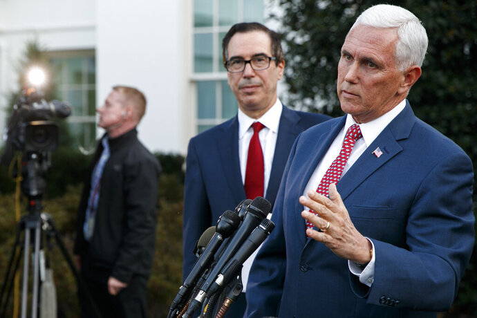 Vice President Mike Pence, with Treasury Secretary Steven Mnuchin, speaks to reporters outside the West Wing of the White House, Monday, Oct. 14, 2019, in Washington. The U.S. is calling for an immediate ceasefire in Turkey's strikes against Kurds in Syria, and is sending Pence to lead mediation effort (AP Photo/Jacquelyn Martin)