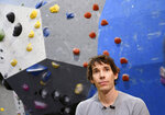 In this June 18, 2019, photo, professional rock climber Alex Honnold is interviewed at the Earth Treks gym in Englewood, Colo. Honnold is trying to get a grip on life in the aftermath of the Academy Award winning documentary