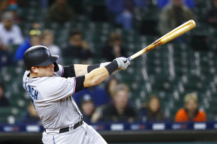 Miami Marlins' Chad Wallach hits an RBI double in the 11th inning of the team's baseball game against the Detroit Tigers in Detroit, Tuesday, May 21, 2019. (AP Photo/Paul Sancya)