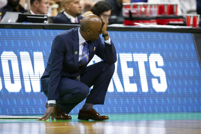 Yale head coach James Jones reacts to a shot by his team during the second half of the first round men's college basketball game against LSU in the NCAA Tournament in Jacksonville, Fla., Thursday, March 21, 2019. (AP Photo/Stephen B. Morton)