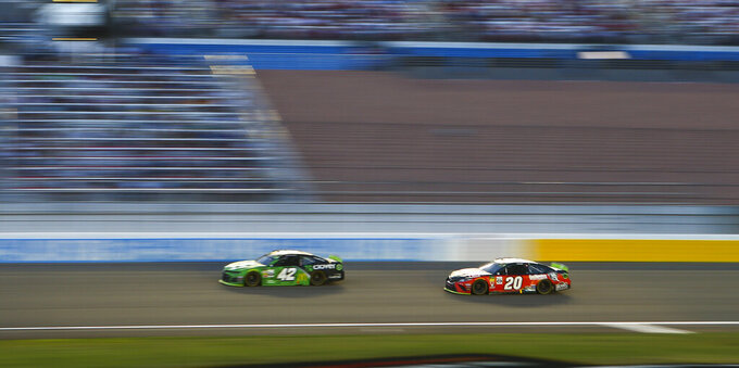 Kyle Larson (42) and Erik Jones (20) drive during a NASCAR Cup Series auto race at the Las Vegas Motor Speedway on Sunday, Sept. 15, 2019. (AP Photo/Chase Stevens)