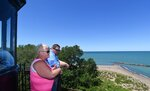 In this July 7, 2018 photo, Mandy and P.J. Kosakowski of Pittsburgh tour the Presque Isle Lighthouse at Presque Isle State Park near Erie, Pa. Attendance is up markedly at Presque Isle Lighthouse, said Michael Sullivan, executive director of the lighthouse located near Beach 9. (Jack Hanrahan