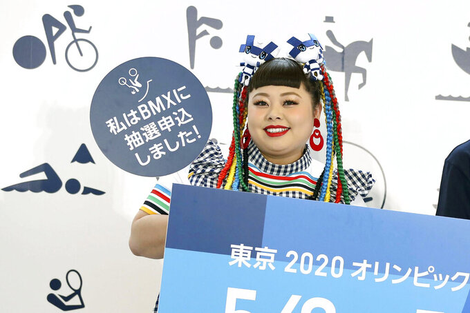 """Naomi Watanabe, a Japanese well-known entertainer, attends an event to promote the lottery application for tickets for the 2020 Tokyo Olympics in Tokyo in May 2019. Tokyo Olympics creative director Hiroshi Sasaki is resigning Wednesday, March 17, 2021 after making demeaning comments about the well-known female celebrity. Sasaki was in charge of the opening and closing ceremonies for the Olympics, which are to begin on July 23, 2021. Last year he told planning staff members that Watanabe could perform in the ceremony as an """"Olympig."""" (Kyodo News via AP)"""