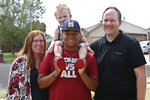 The Dunn family is pictured outside their home Friday, June 12, 2020, in Oklahoma City. From left Sarah Dunn, Cooper Dunn, Izzy Simons and Josh Dunn. Sarah Dunn, who grew up in rural Kansas, has learned much about race since she and her husband, Josh, took custody of Izzy six years ago. (AP Photo/Sue Ogrocki)