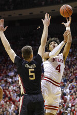 Indiana forward Trayce Jackson-Davis (4) shoots over Florida State center Balsa Koprivica (5) during the first half of an NCAA college basketball game Tuesday, Dec. 3, 2019, in Bloomington, Ind. (AP Photo/Darron Cummings)