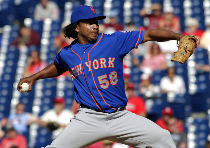 FILE - In this June 1, 2014, file photo, New York Mets relief pitcher Jenrry Mejia (58) throws against the Philadelphia Phillies in the 11th inning of a baseball game in Philadelphia. Mejia, allowed back into baseball after a lifetime ban caused by three positive drug tests, has agreed to a minor league contract with the Boston Red Sox. (AP Photo/H. Rumph Jr., File)