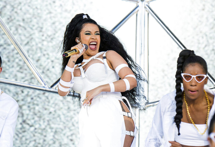FILE - In this April 22, 2018 file photo, Cardi B performs at the Coachella Music & Arts Festival in Indio, Calif. The 25-year-old rapper welcomed Kulture Kiari Cephus during a post on Instagram Wednesday, July 11. The girl was born Tuesday. (Photo by Amy Harris/Invision/AP, File)