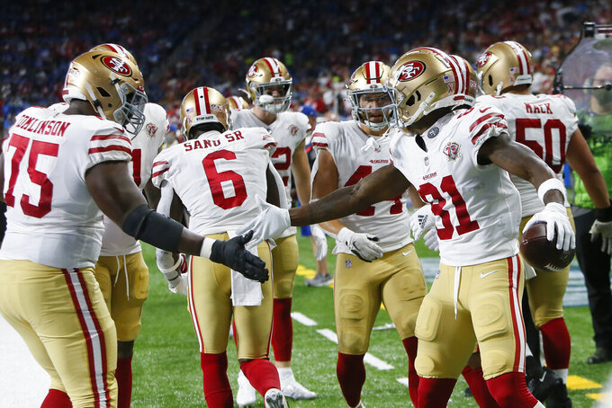 San Francisco 49ers wide receiver Trent Sherfield celebrates scoring on a five yard touchdown reception against the Detroit Lions in the first half of an NFL football game in Detroit, Sunday, Sept. 12, 2021. (AP Photo/Duane Burleson)