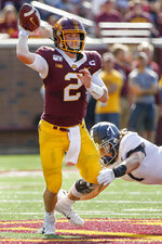 Minnesota quarterback Tanner Morgan (2) passes under the pressure of Georgia Southern linebacker Lane Ecton (7) in the second quarter of an NCAA college football game Saturday, Sept. 14, 2019, in Minneapolis. (AP Photo/Bruce Kluckhohn)