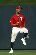 Minnesota Twins' Byron Buxton celebrates after the Twins defeated the Chicago White Sox 11-4 in a baseball game Friday, May 24, 2019, in Minneapolis. (AP Photo/Jim Mone)
