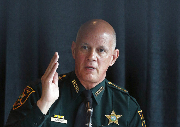 Sheriff and chairperson, Bob Gualtieri, of Pinellas county, Fla., speaks during a state commission meeting as they investigate the Marjory Stoneman Douglas High School massacre and how Broward county school district and others access threats, on Tuesday, July 10, 2018, in Sunrise, Fla. (AP Photo/Brynn Anderson)