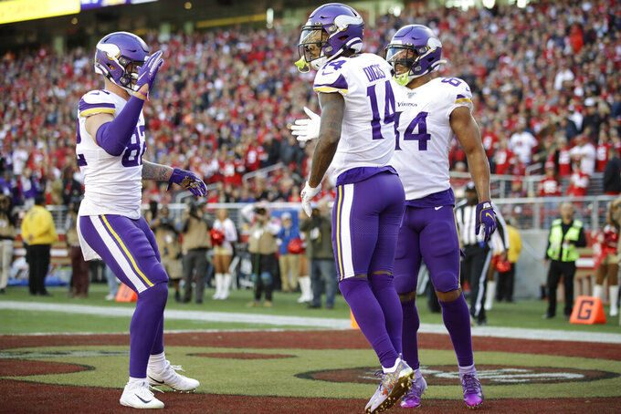 Minnesota Vikings wide receiver Stefon Diggs (14) celebrates with teammates after he scored a touchdown against the San Francisco 49ers during the first half of an NFL divisional playoff football game, Saturday, Jan. 11, 2020, in Santa Clara, Calif. (AP Photo/Ben Margot)