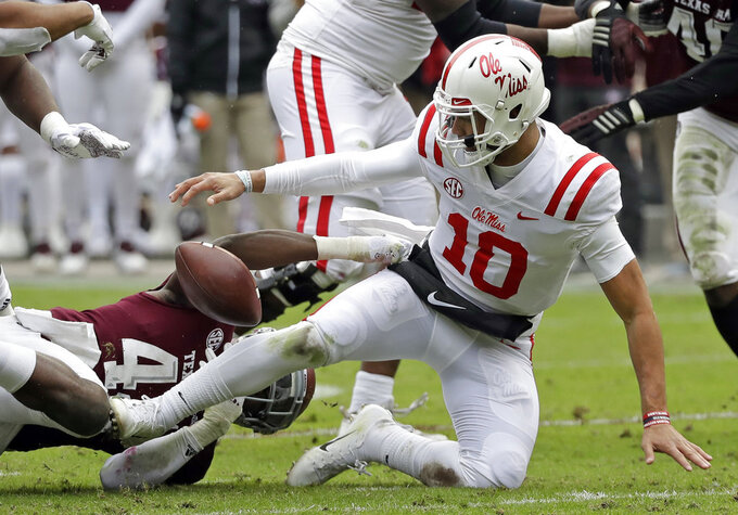 Mississippi Rebels quarterback Jordan Ta'amu (10) fumbles the football as Texas A&M linebacker Otaro Alaka (42) tackles him during the first half of an NCAA college football game Saturday, Nov. 10, 2018, in College Station, Texas. Texas A&M recovered the fumble. (AP Photo/David J. Phillip)