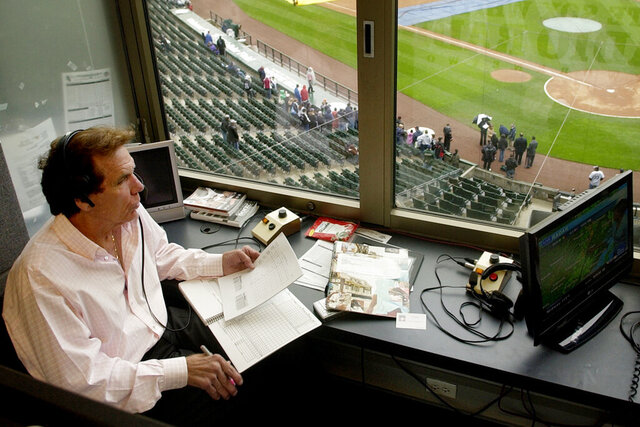 In this April 28, 2008, photo, radio broadcaster Ed Farmer is shown in the broadcast booth before a baseball game between the Baltimore Orioles and Chicago White Sox in Chicago. Farmer, a former All-Star reliever who spent nearly three decades as a radio broadcaster for the Chicago White Sox and became an advocate for organ donation, has died. He was 70. The White Sox said Thursday, April 2, 2020, he died the previous night in Los Angeles following complications from a previous illness. (Rich Hein/Chicago Sun-Times via AP, File)