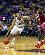 Missouri's Javon Pickett, left, drives toward the basket past Alabama's Tevin Mack during the first half of an NCAA college basketball game, Wednesday, Jan. 16, 2019, in Columbia, Mo. (AP Photo/L.G. Patterson)
