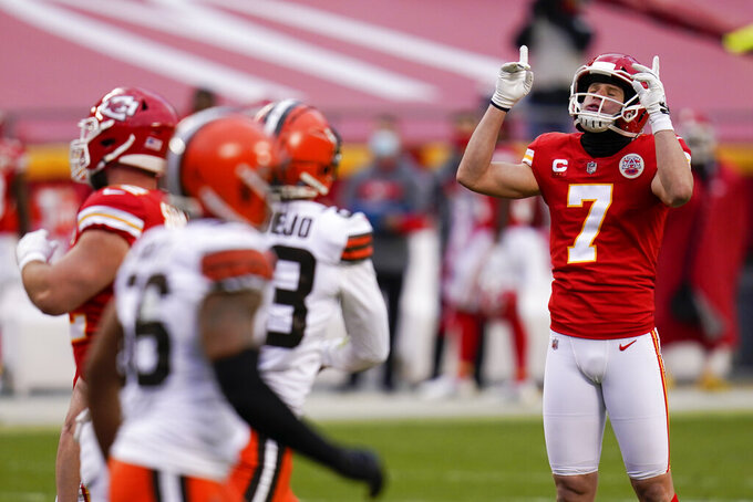 Kansas City Chiefs place kicker Harrison Butker celebrates after kicking a 33-yard field goal during the second half of an NFL divisional round football game against the Cleveland Browns, Sunday, Jan. 17, 2021, in Kansas City. (AP Photo/Jeff Roberson)
