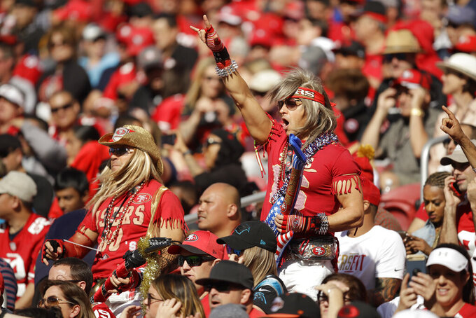 A San Francisco 49ers fan cheers at Levi's Stadium during the second half of an NFL football game between the 49ers and the Carolina Panthers in Santa Clara, Calif., Sunday, Oct. 27, 2019. (AP Photo/Ben Margot)