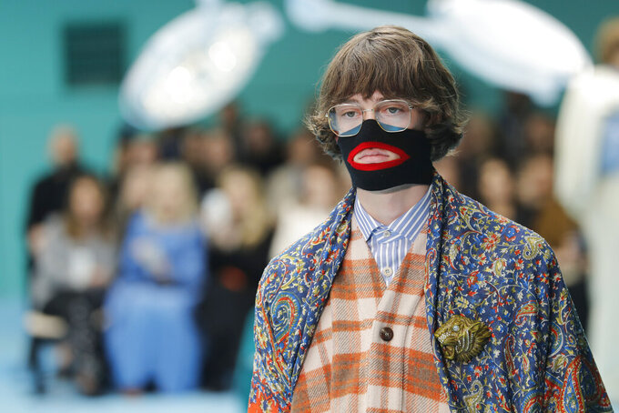 FILE - In this Feb. 21, 2018, file photo, a model wears a creation as part of the Gucci women's Fall/Winter 2018-2019 collection, presented during the Milan Fashion Week, in Milan, Italy. Luxury fashion got a whole lot of blowback when the brands lined up social media posts to show solidarity with Black Lives Matters protests. Global fashion brands have faced racial backlashes in the past, notably in the wake of scandals like the Gucci knitwear recalling blackface, Prada's Little Black Sambo bag charm and Dolce&Gabbana's anti-Asian comments. (AP Photo/Antonio Calanni, File)