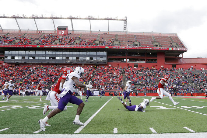 Rutgers running back Isaih Pacheco, right, avoids a tackle by Northwestern defensive back JR Pace on his way to a touchdown run during the first half of an NCAA college football game, Saturday, Oct. 20, 2018, in Piscataway, N.J. (AP Photo/Julio Cortez)
