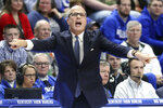 Fairleigh Dickinson head coach Greg Herenda directs his team during the first half of an NCAA college basketball game against Kentucky in Lexington, Ky., Saturday, Dec. 7, 2019. (AP Photo/James Crisp)