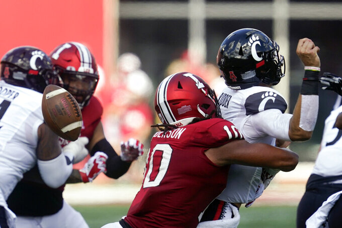 Cincinnati quarterback Jack Perry (10) fumbles as he is hit by Indiana's Ryder Anderson (10) during the first half of an NCAA college football game, Saturday, Sept. 18, 2021, in Bloomington, Ind. (AP Photo/Darron Cummings)